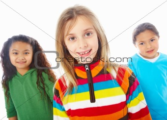 Portrait of three young children standing besides each other over white background