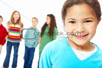 Portrait of smiling young girl in front with her  friends standing at the back ground over white background