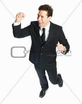 Portrait of a excited successful smart young business man on white background