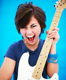 Energetic young woman playing guitar