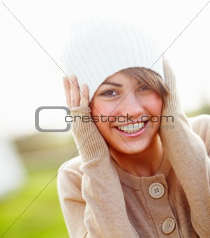 Portrait of an joyful  young female smiling outside