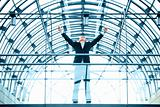 Exited businessman with hands raised