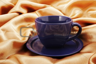 Cup and saucer on fabric
