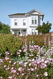 Flowers in Front of Old Victorian Farmhouse
