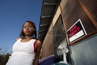 African-American woman in front of house