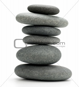 Six pebbles stacked isolated on white