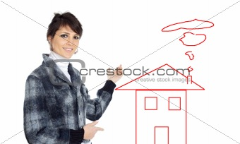 Business woman indicating the houseattractive and elegant busine