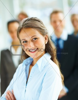 Portrait of a charming business woman with other colleagues in the background