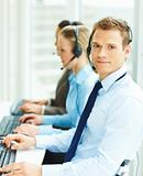 Group of call center employees working in office