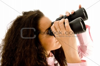 smart young businesswoman looking through binoculars
