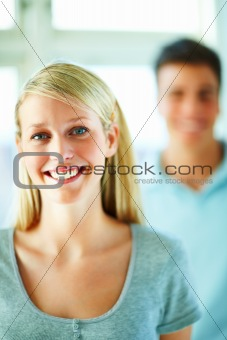 Protrait of young woman with her friend in background