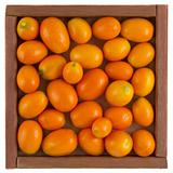 kumquats in a rustic, wooden box