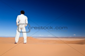 Man standing on a desert dune