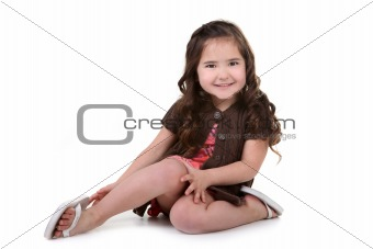 Charming Brown Eyed Toddler Girl on White Background