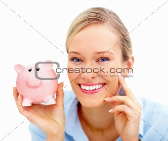 Attractive happy  Young happy woman holding a  piggybank