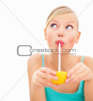 Portrait of a young woman sipping juimce against white background