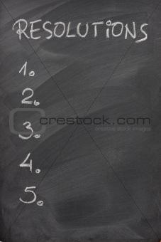 list of resolutions on a blackboard