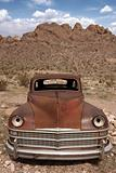 Old Rusted Out Car in the Desert