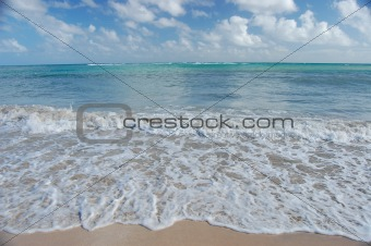 Waves and sandy beach
