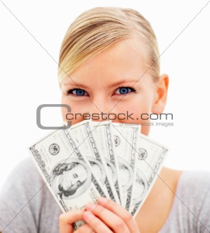 Portrait of a young woman holding currency over white background