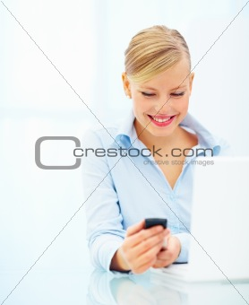 Young charming female showing her mobile isolated over white background