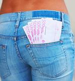 Midsection of a lady currency notes in the pocket