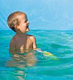 Little boy in the yard pool