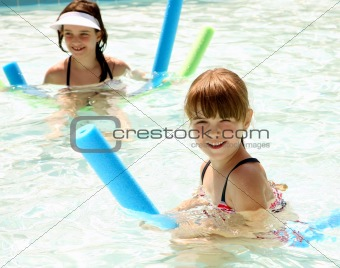 Sisters Happily Playing in a Swimming