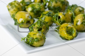 olives on a square white plate