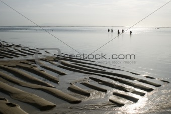 Fishermen on ocean beach, outflow, morning, Indonesia