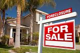 Foreclosure For Sale Real Estate Sign in Front of House.