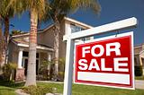For Sale Real Estate Sign in Front of House.