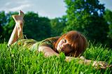 Young beautiful woman lying on grass
