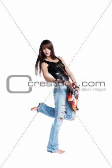Beautiful rock-n-roll girl playing a guitar