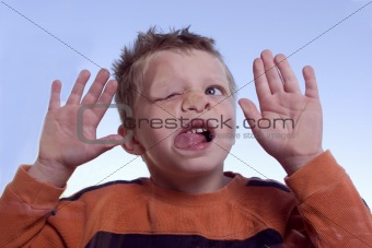 Boy with face against glass