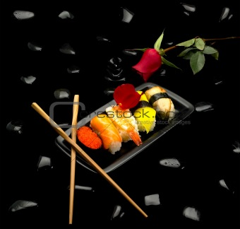 assorted sushi plate and red rose