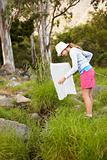 Young girl checking her fishing net at the forest