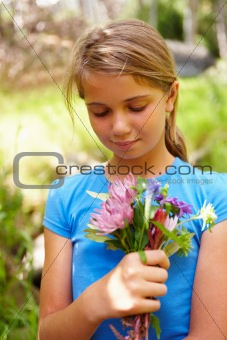 Closeup of young woman holding flowers