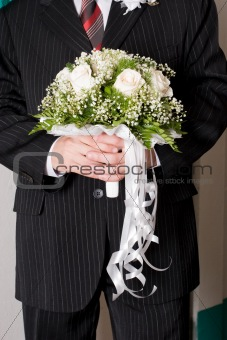 a beautiful rose bouquet in the hands of a man