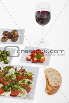 antipasti misti and bread on white plates