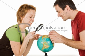 Couple looking at globe