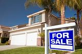 Blue For Sale Real Estate Sign in Front of House.