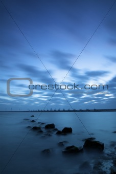 a dramatic blue sunrise over the ocean in Holland