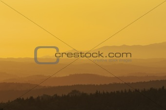 a colorful orange and yellow sunset in Tuscany