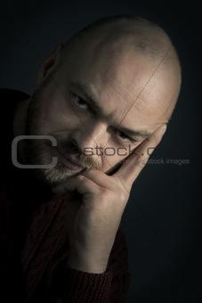 adult man portrait  on a dark background