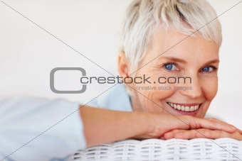 Smiling senior lady relaxing at home
