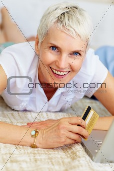 Portrait of a mature woman holding credit card