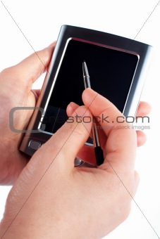 Business woman writing on a pda organizer