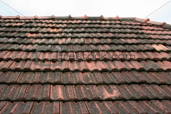 old roof coated by rooftiles