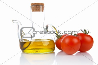 Tomatoes and oilcan